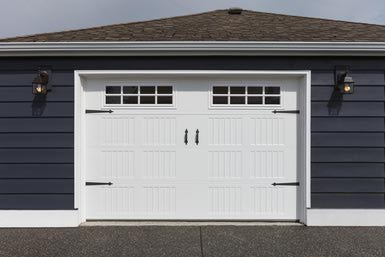 white garage door on a blue house